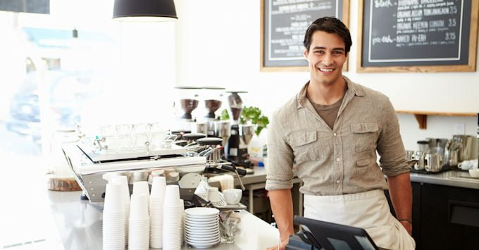 Guy leaning against coffee counter